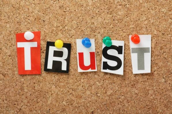 The word Trust on a cork notice board